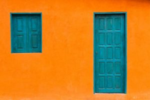 Bright orange building with turquoise door | | All rights reserved by PANAMAEXPATINFO.COM